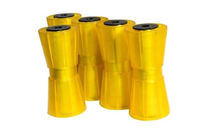 Set of 5 yellow keel rollers for boat trailers. Knott